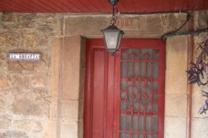 Dintel Casa de La Obra Pía - El Corraldusu, Urbiés