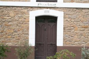 Inscripción en el dintel Villa de la Losa - Cuna